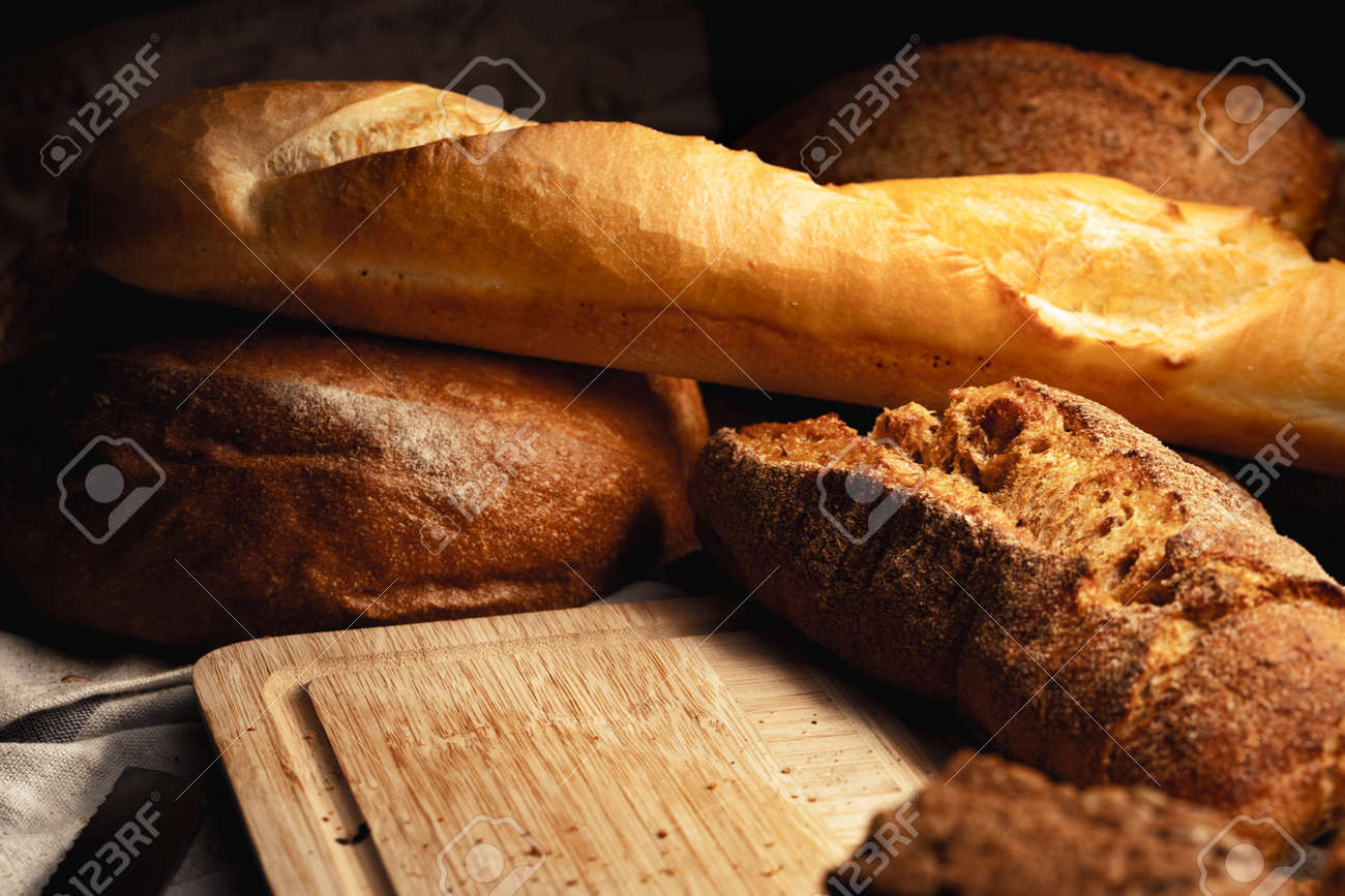 Cut bread assortment for a background, close up photo - 169476346