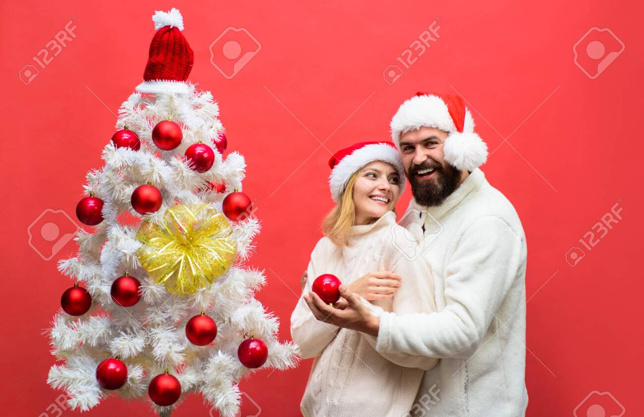 A Christmas Miracle.Christmas Miracle Man And Woman Decorating A Christmas Tree