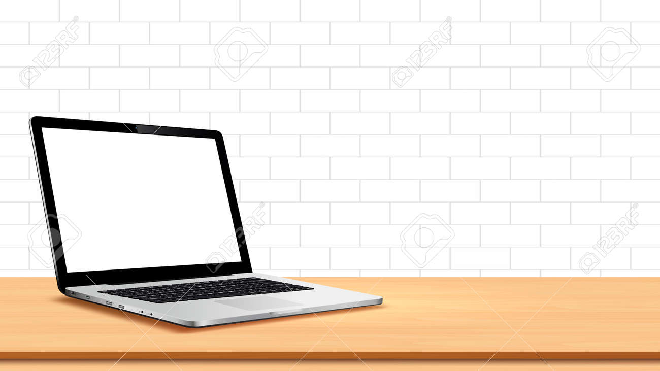 Laptop on table against white wall - 157303253