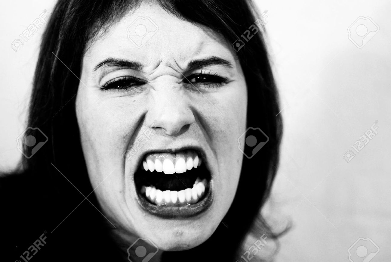 Black and white shot of mad, screaming woman. Stock Photo - 9293467