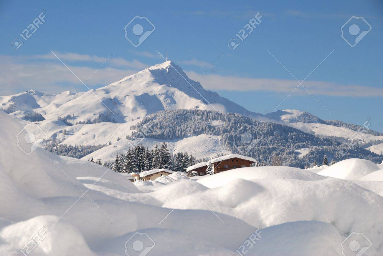 Snow covered house in austrian winter landscape Stock Photo - 12394274