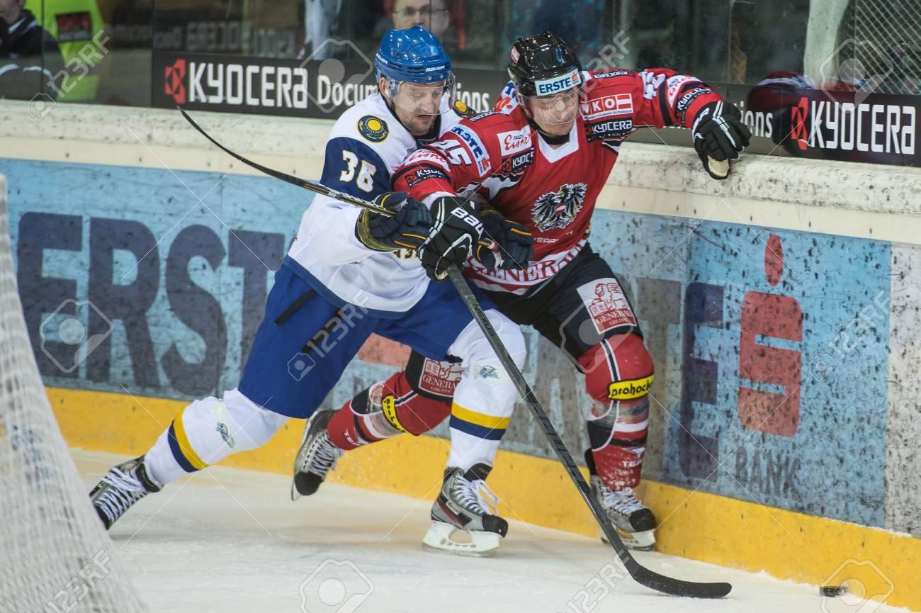 VIENNA - FEB 3: International hockey game between Austria and Kazakhstan. Dmitri Upper hits David Schuller to the boards on February 3, 2013 at Albert Schultz Halle in Vienna, Austria. Stock Photo - 17951611