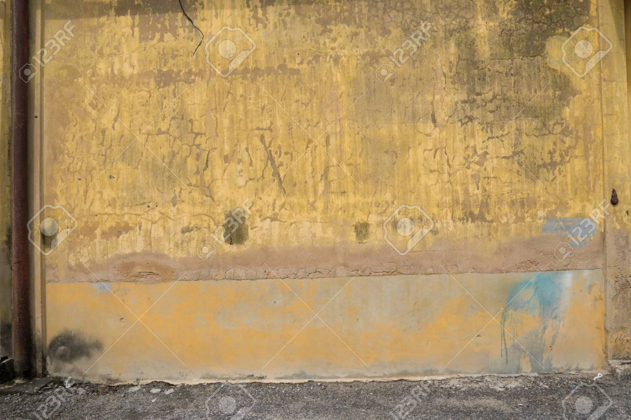Texture Of Old Yellow Vintage Wall Of Warehouse With Rusted Iron ...