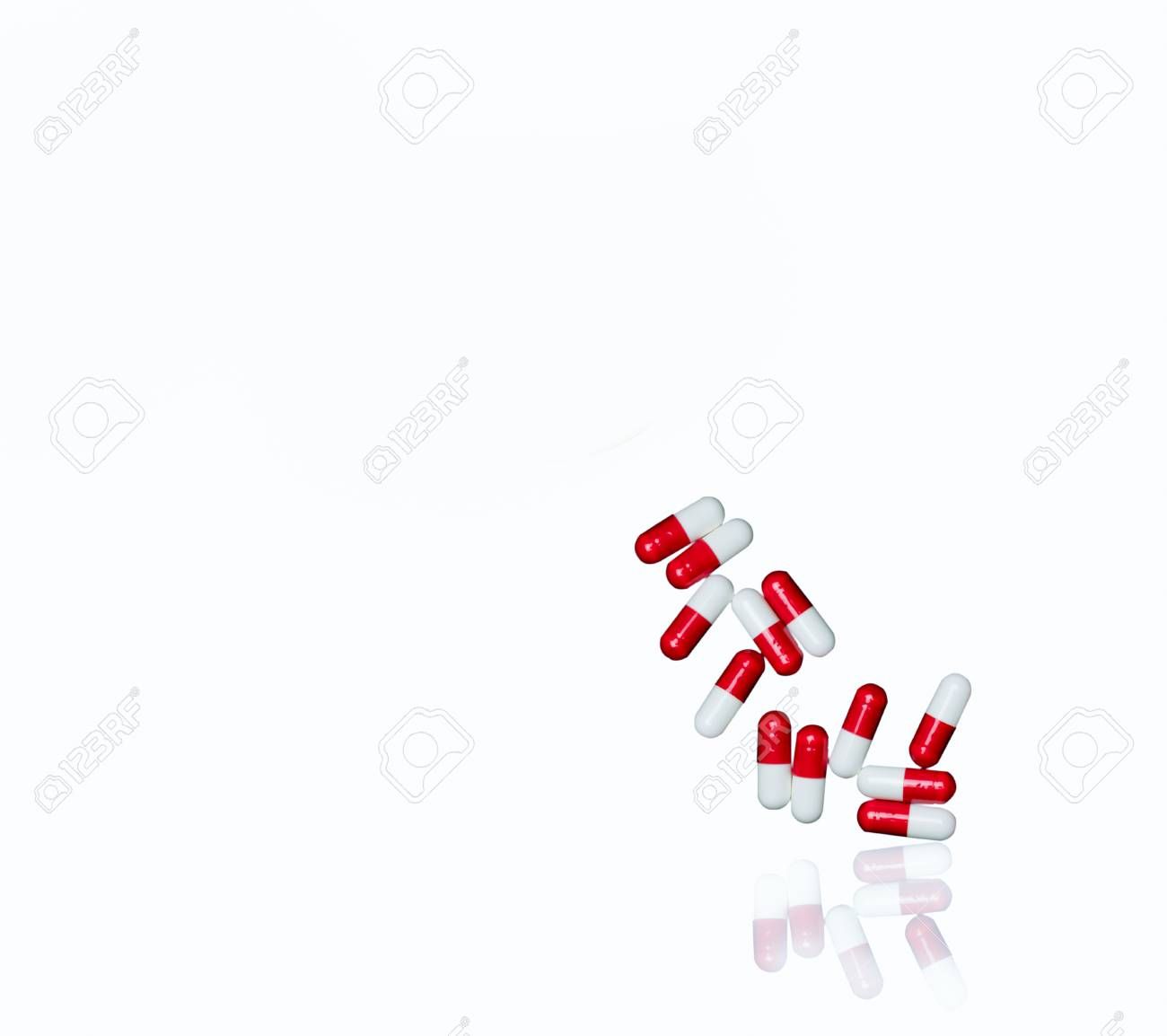 Red, white antibiotic capsules pills isolated on white background