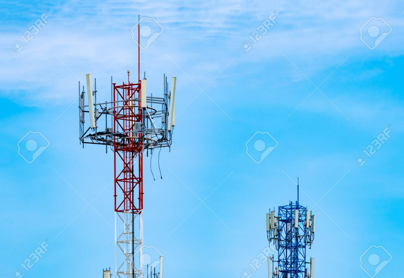 Telecommunication tower with blue sky and white clouds background. Antenna on blue sky. Radio and satellite pole. Communication technology. Telecommunication industry. Mobile or telecom 4g network. - 131754900