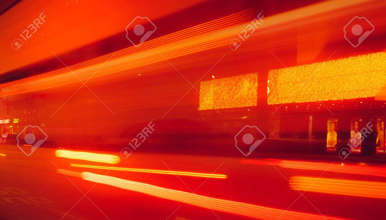 City street in the night with blurred fast speed car light. Red and yellow light at the rod beside the building. Night light abstract background. Blurred motion of light on the road. - 141374741
