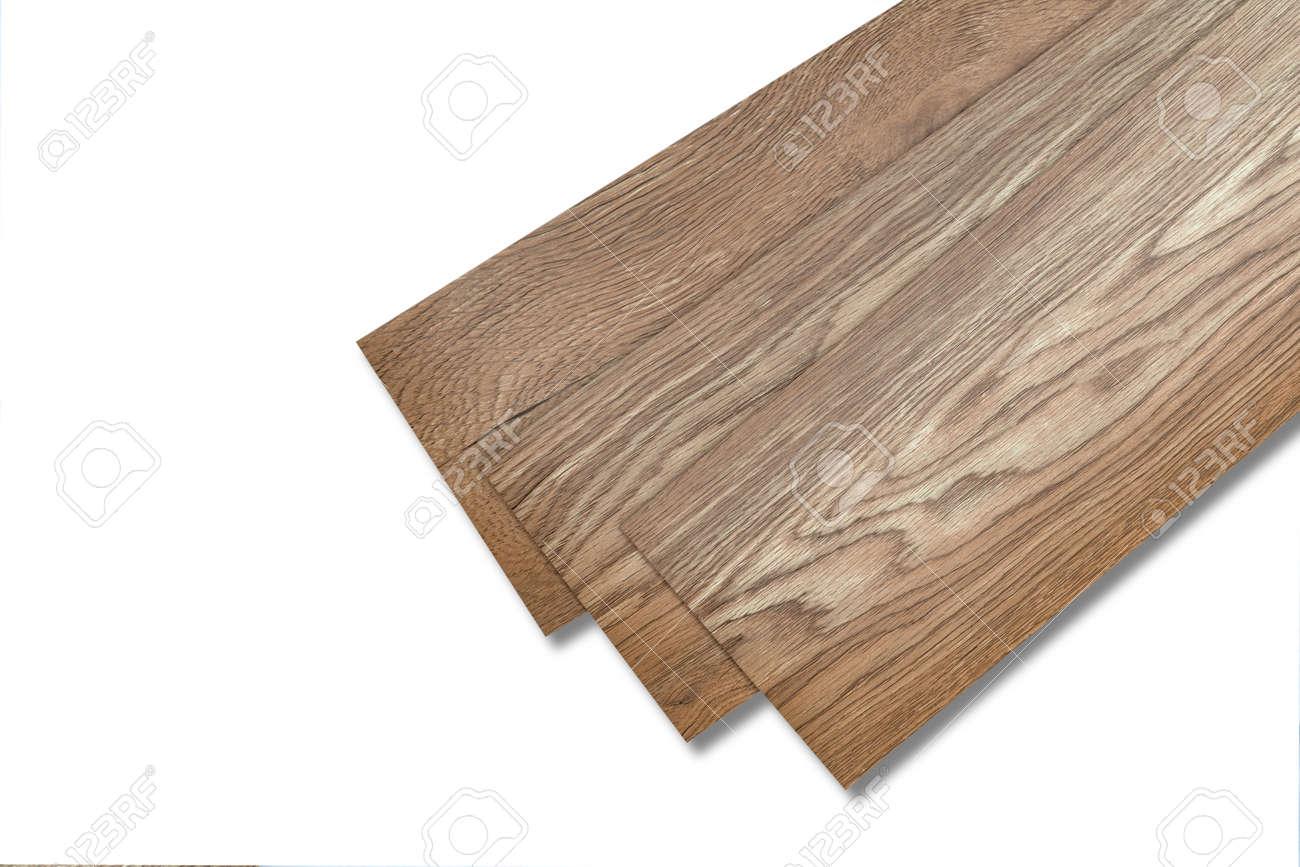 Vinyl tiles for home interior design for house renovation. New wooden pattern vinyl tile. Vinyl flooring material. Polymer vinyl sheet for new home floor. PVC material isolated on white background. - 169727895