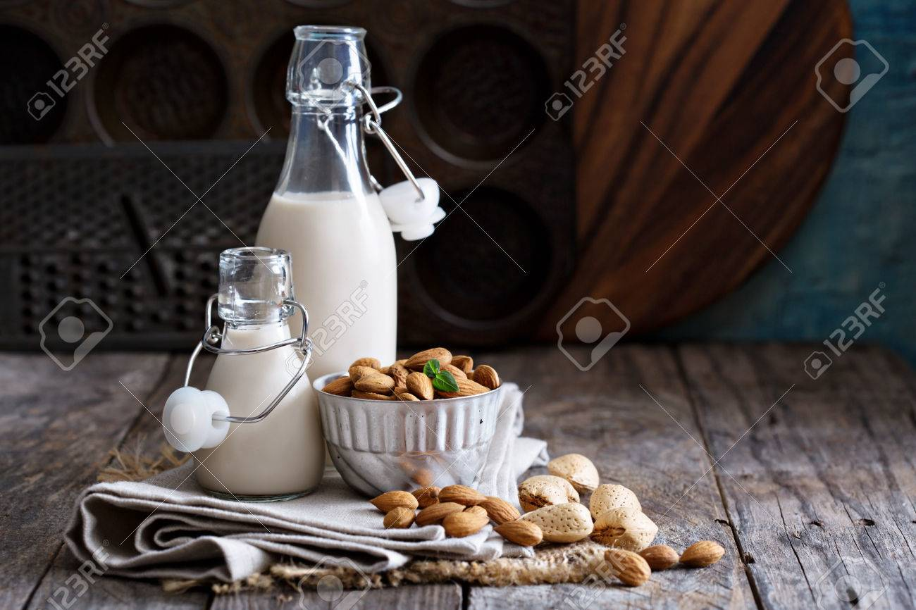 Almond nut vegan milk non dairy in different bottles with copy space - 50965515