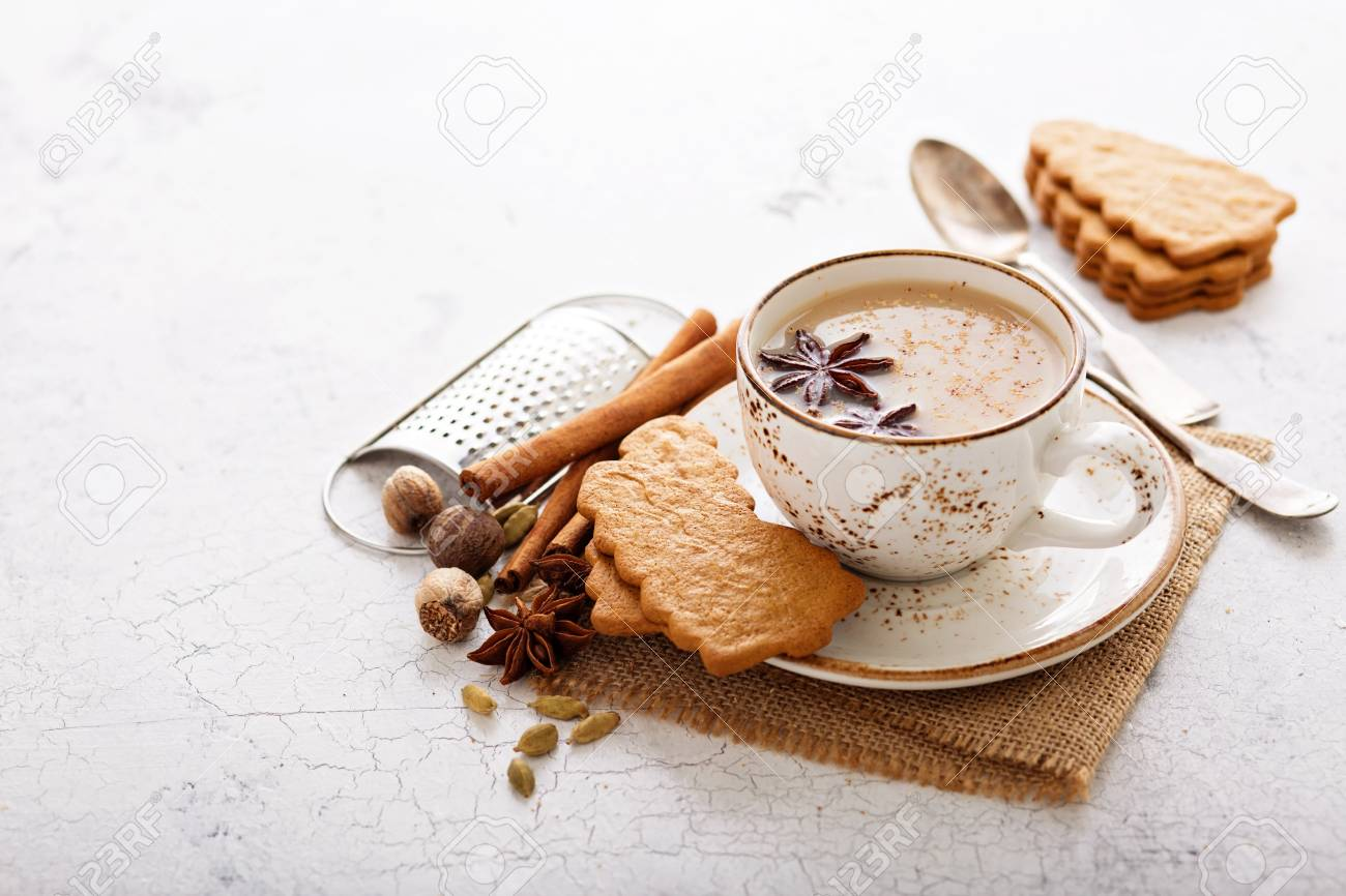 Masala tea in ceramic cup with spices and gingerbread cookies - 122038329