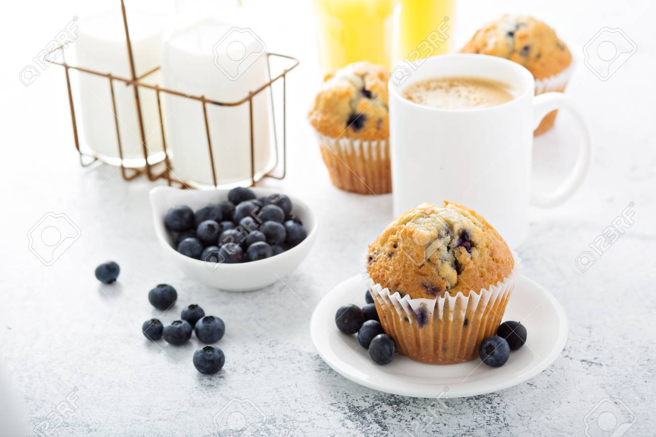 breakfast with blueberry muffin, big cup of coffee and milk in bottles - 122038409