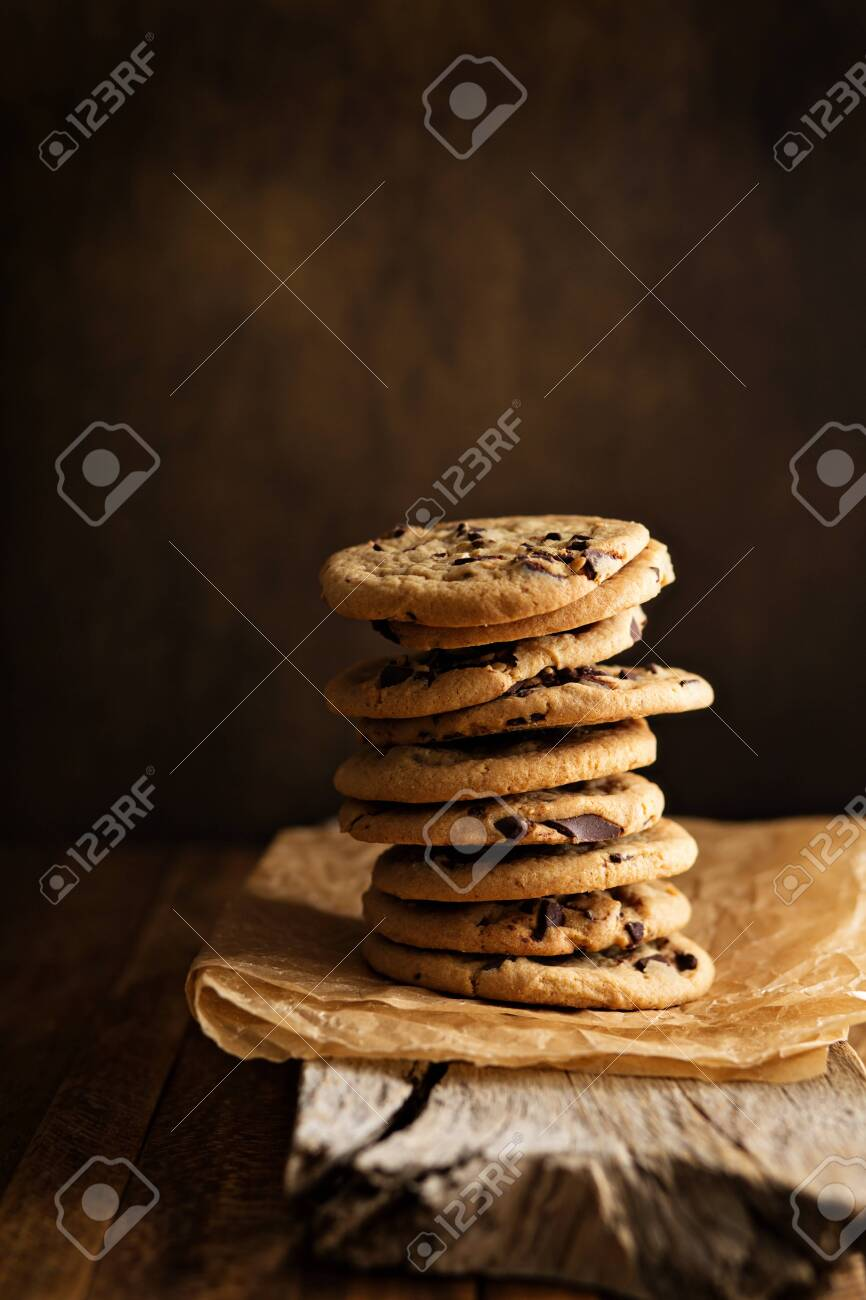 Homemade chocolate chip cookies stacked in a rusting setting - 122038444