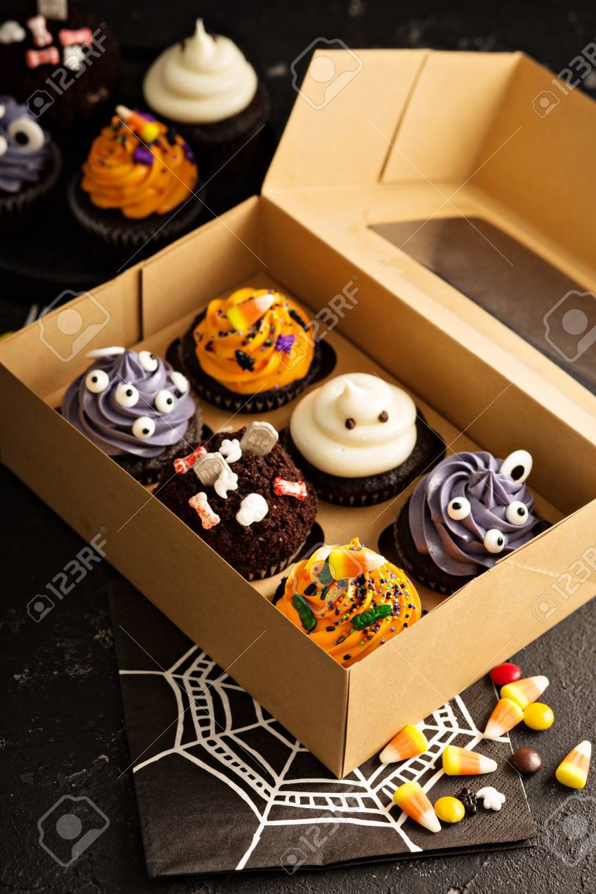 Set Of Festive Halloween Cupcakes And Treats Decorated With Sprinkles