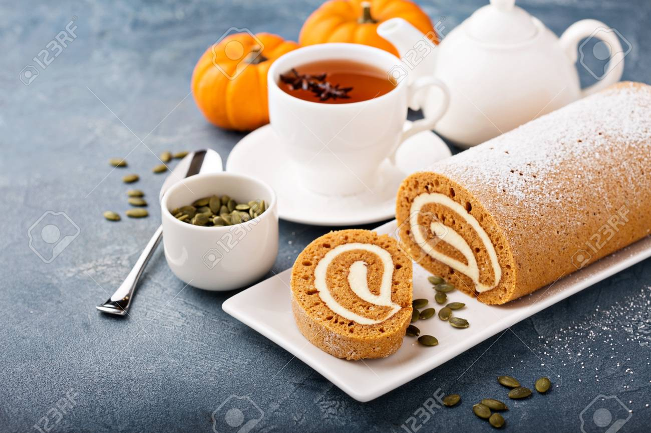 Pumpkin roll with cream cheese frosting - 90942847