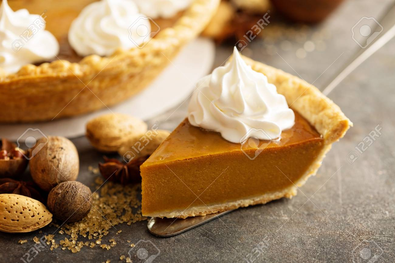 Pumpkin pie with whipped cream - 90943121