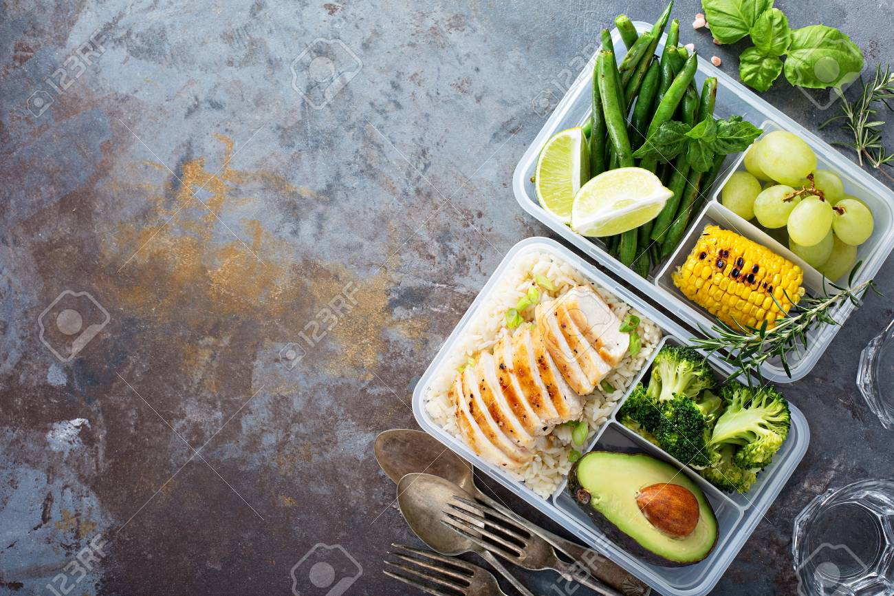 Healthy green meal prep containers with rice and vegetables - 94521820