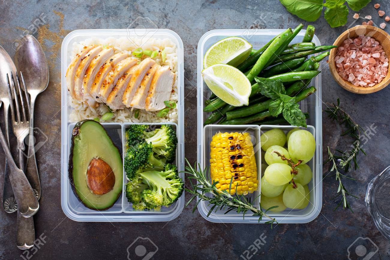 Healthy green meal prep containers with rice and vegetables - 94521822