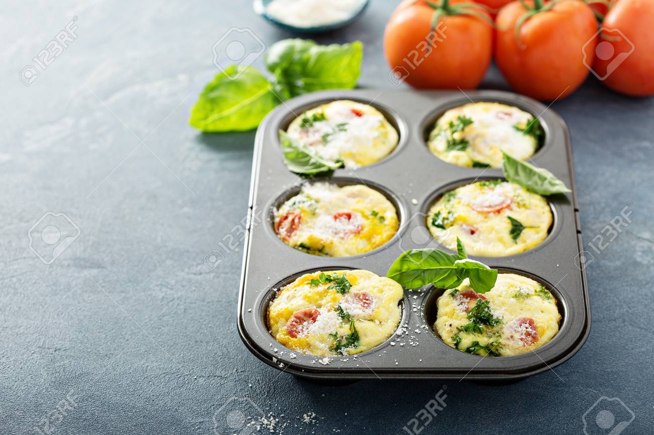 Healthy egg muffins, mini frittatas with tomatoes - 94521829