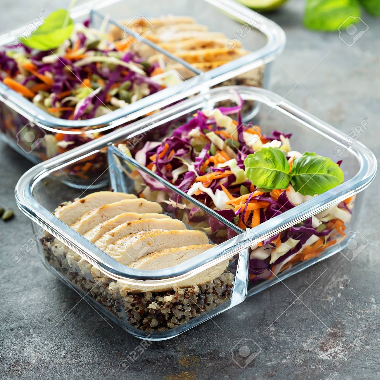 Healthy meal prep containers with quinoa and chicken - 94521831