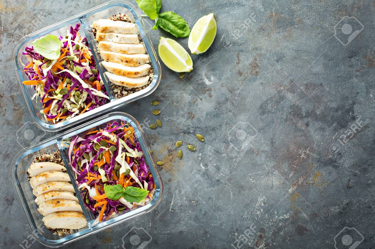 Healthy meal prep containers with quinoa and chicken - 94521832