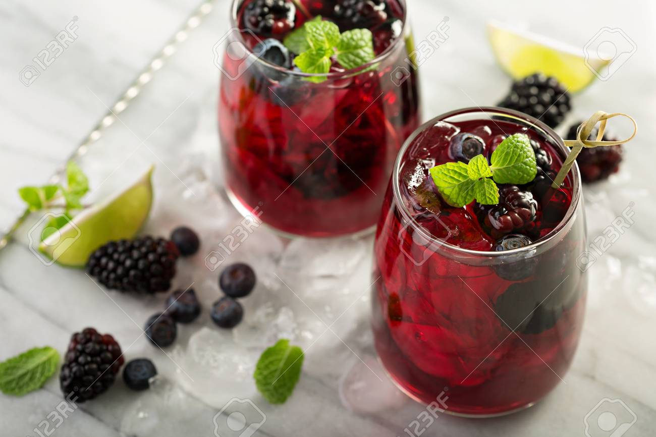 Cold summer berry drink with lime and blackberries - 94427863