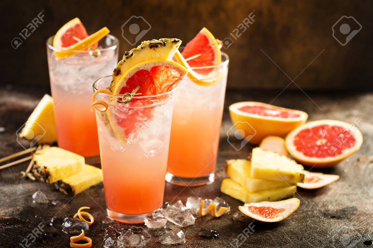 Grapefruit and pineapple cocktail or mocktail, refreshing drink with sparkling water - 94474214