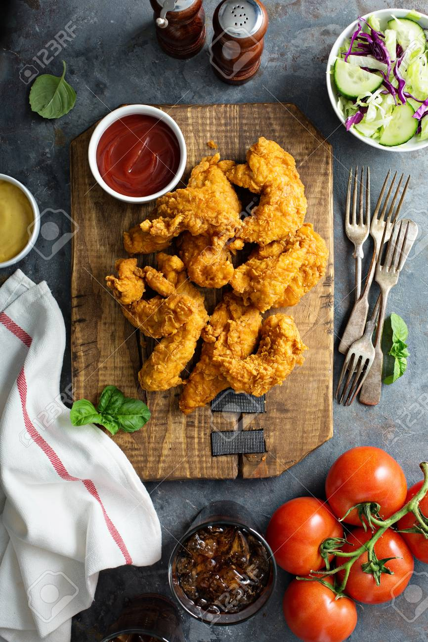 Breaded chicken tenders with ketchup, salad and soda - 94477588