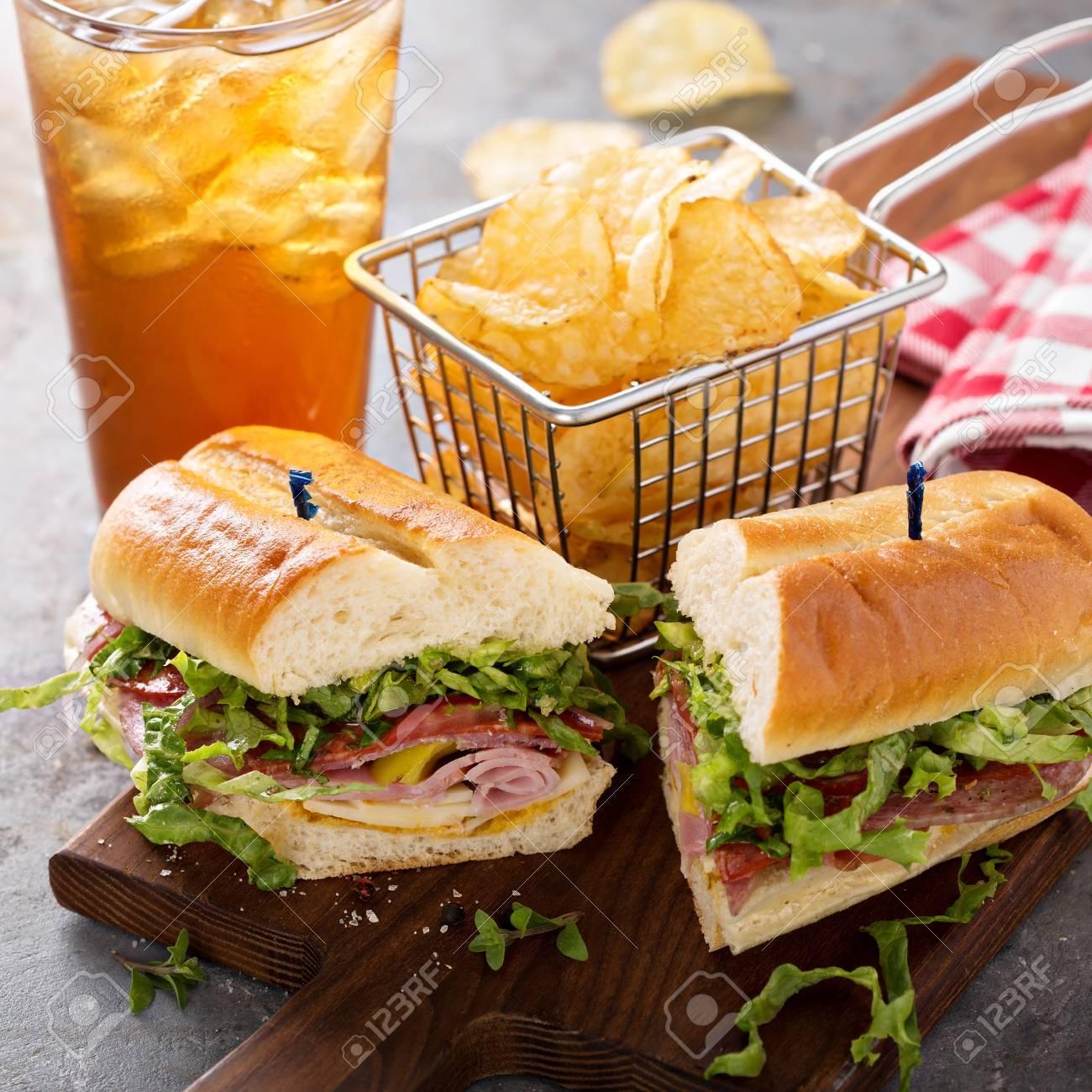 Italian sub sandwich with chips - 98985094