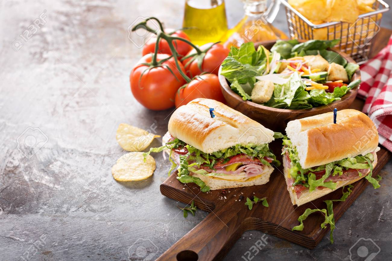 Italian sub sandwich with chips - 98985117