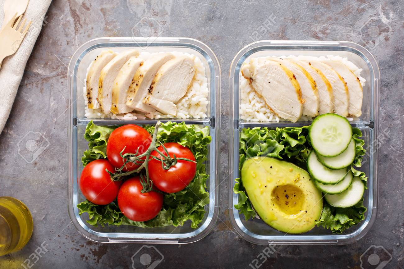 Healthy meal prep containers with chicken and rice - 98985602