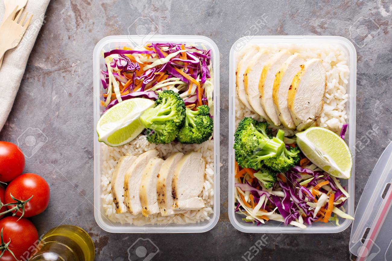 Healthy meal prep containers with chicken and rice - 98985606