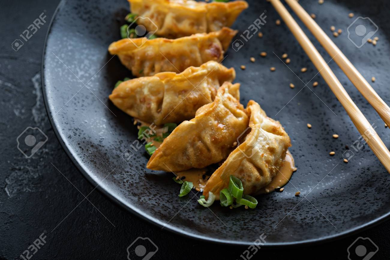 Fried potstickers with green onions - 101740782