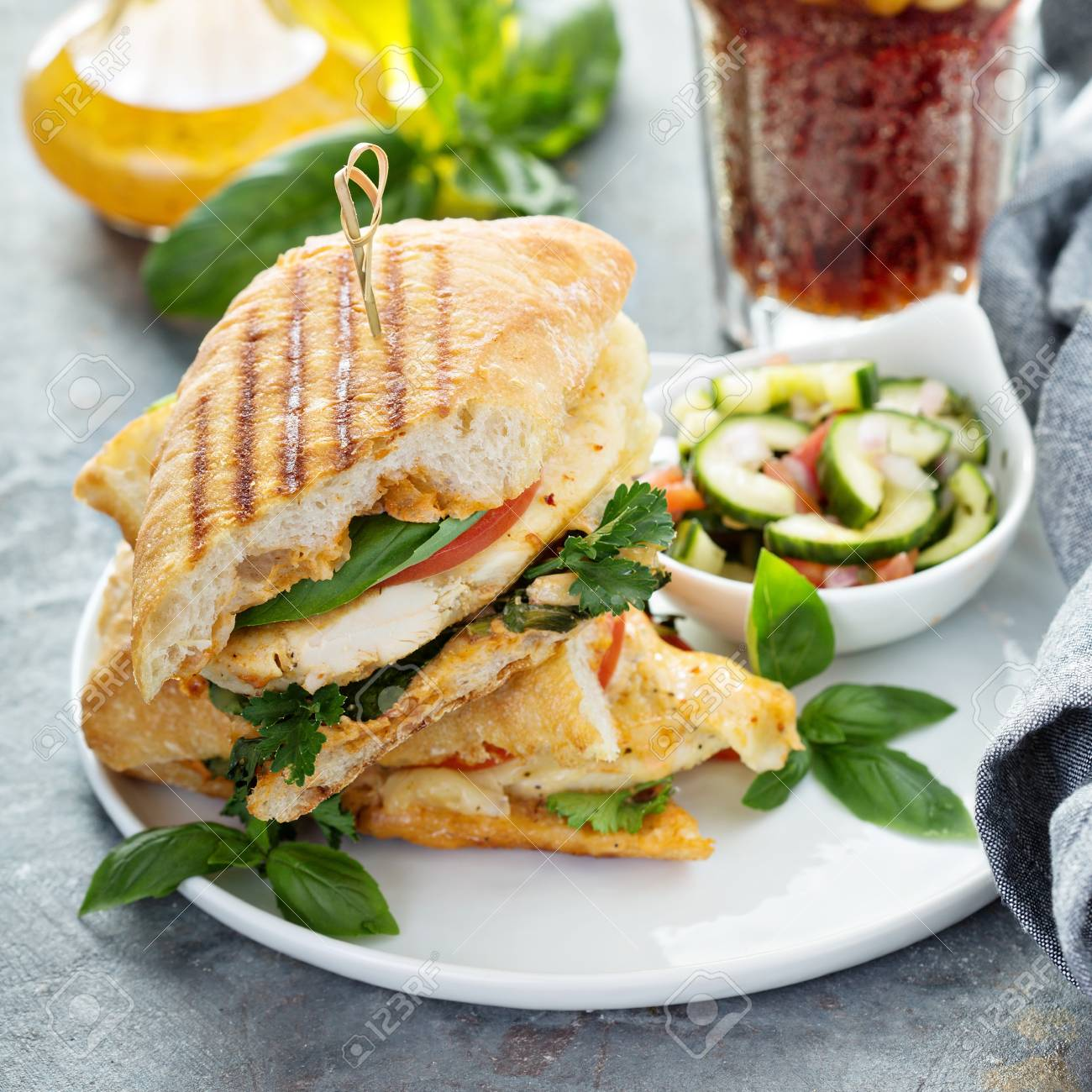 Grilled panini sandwich with chicken and cheese - 103968573