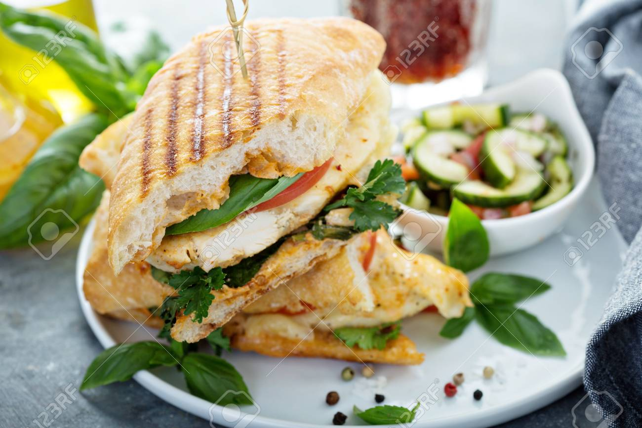 Grilled panini sandwich with chicken and cheese - 103968574