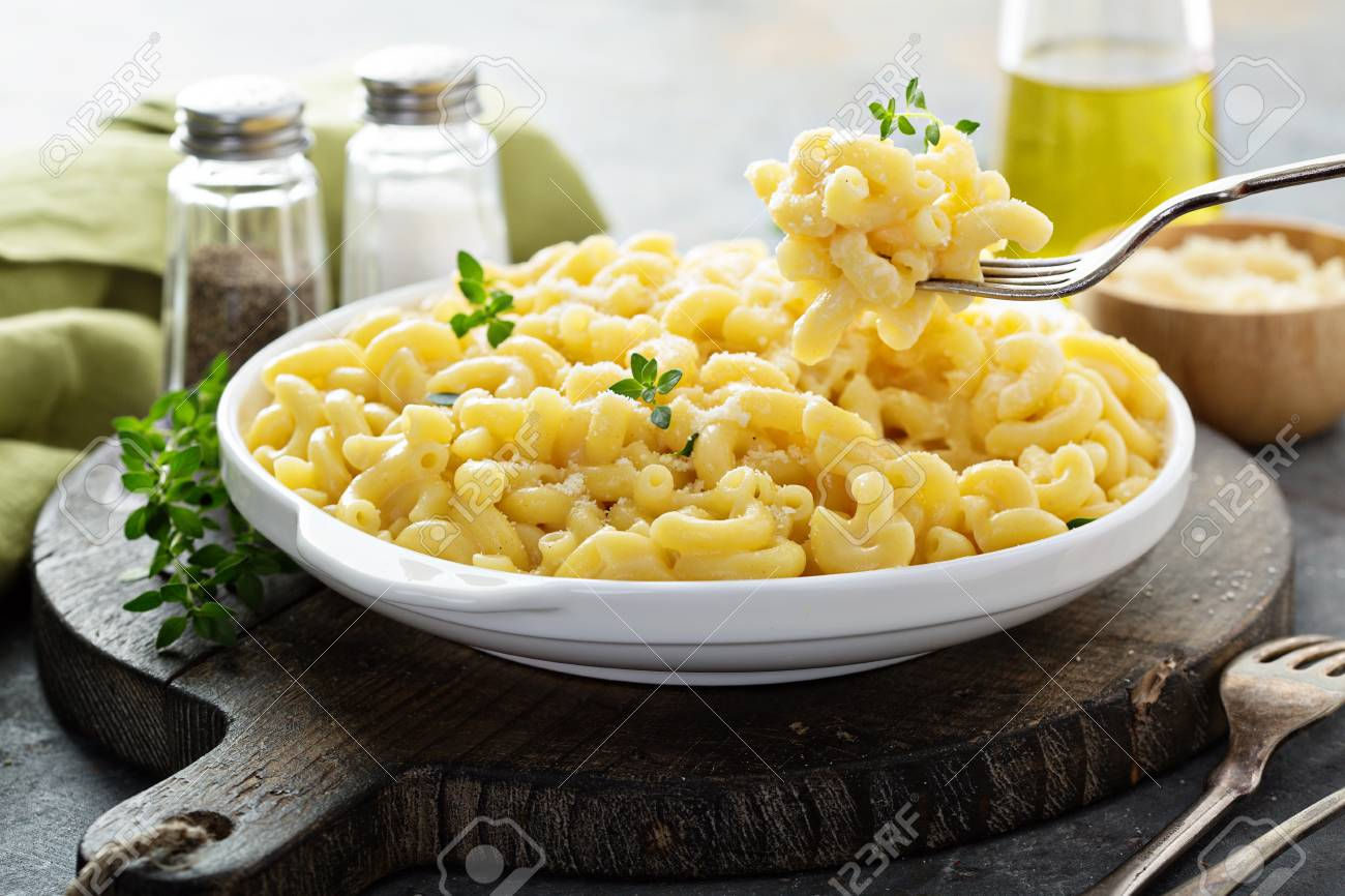 Macaroni and cheese on a white plate - 105738530