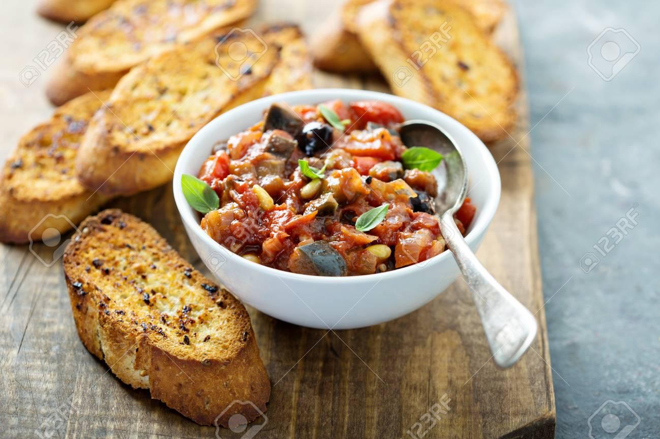 Eggplant caponata with garlic bread - 107982100