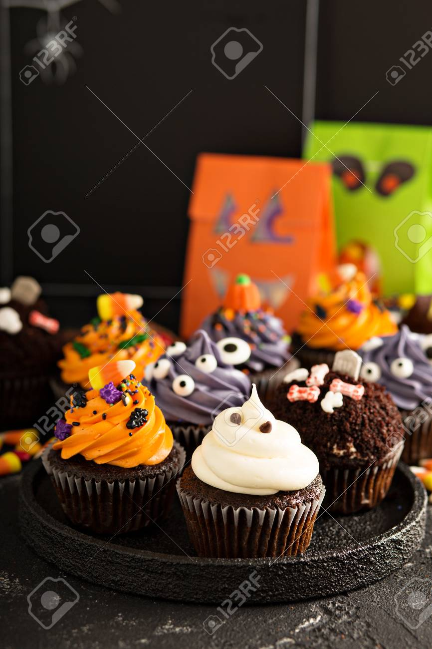 Halloween Cupcakes With Variety Of Spooky Decorations Stock Photo