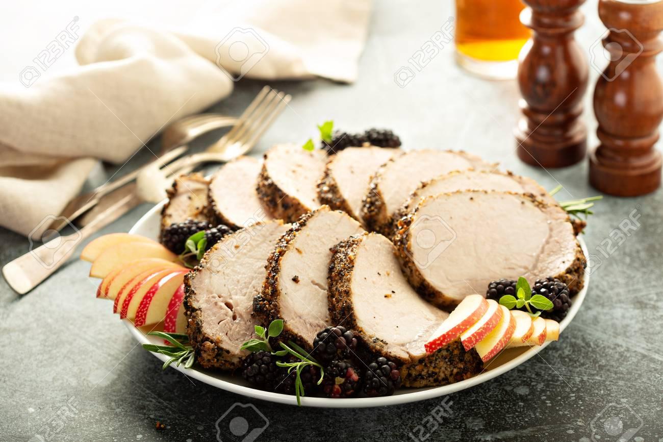 Roasted pork loin with dry rub sliced on a plate - 110715181