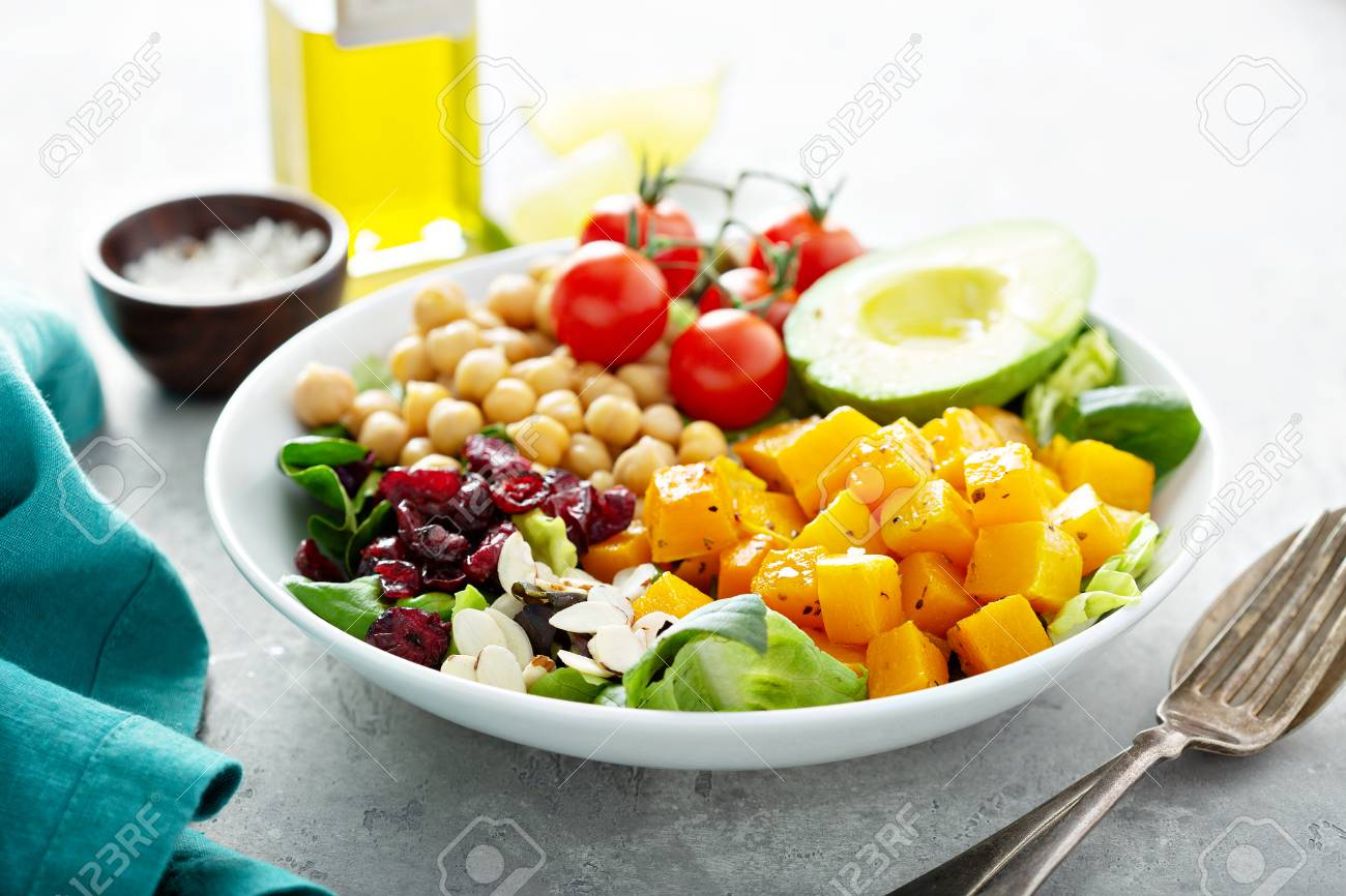Vegan lunch bowl with chickpeas and roasted squash - 117939420