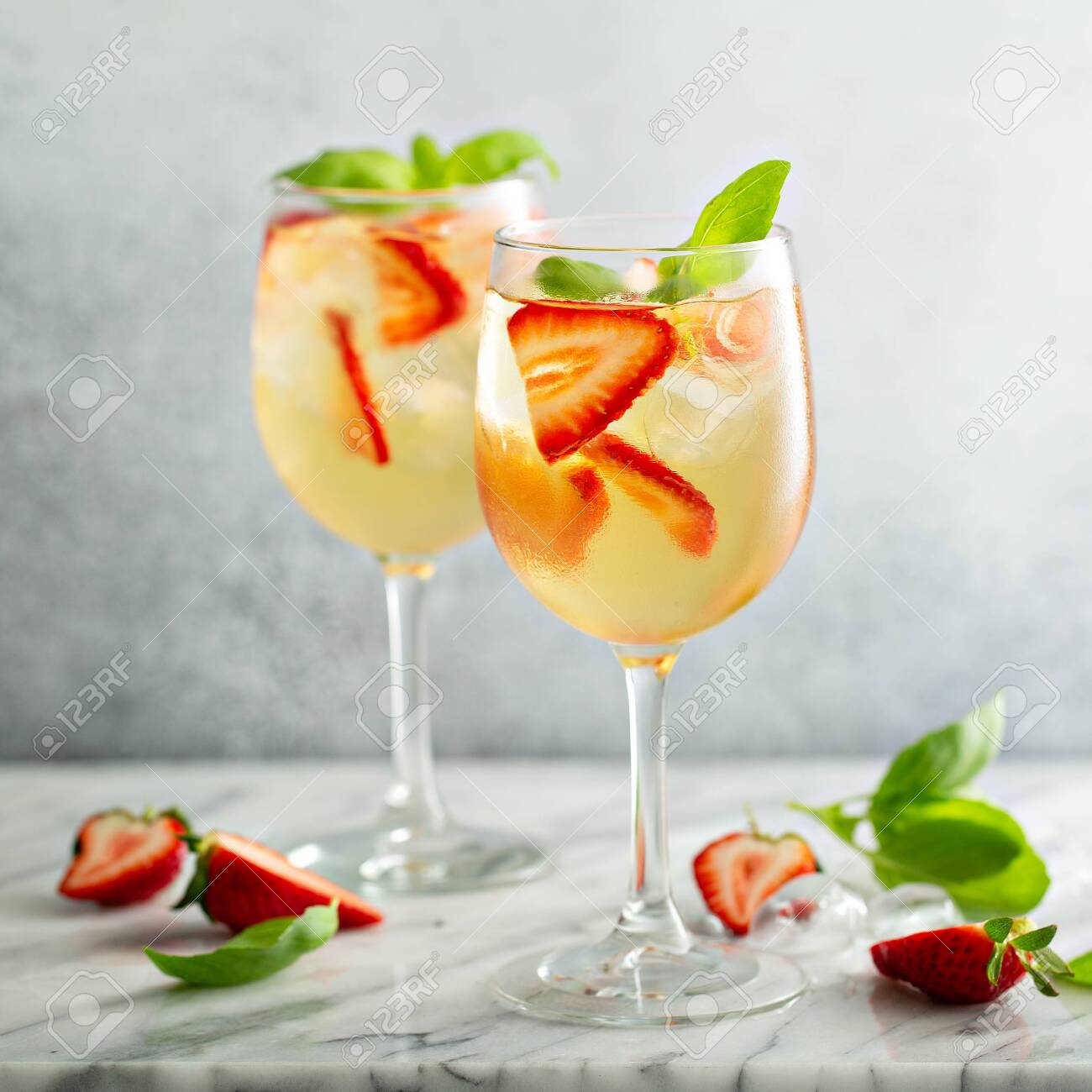 Summer white sangria with strawberries - 127689635
