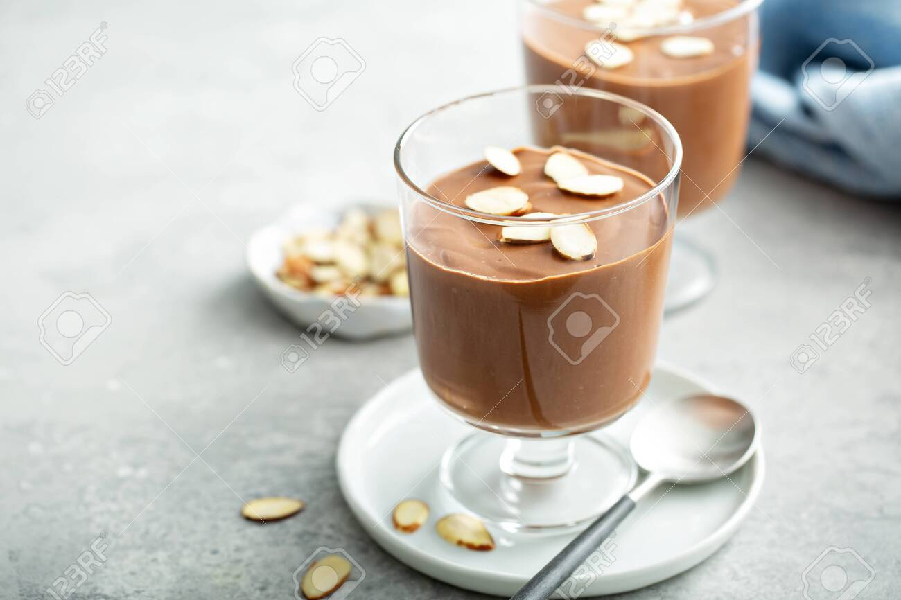 Chocolate pudding with sliced almonds - 127690799