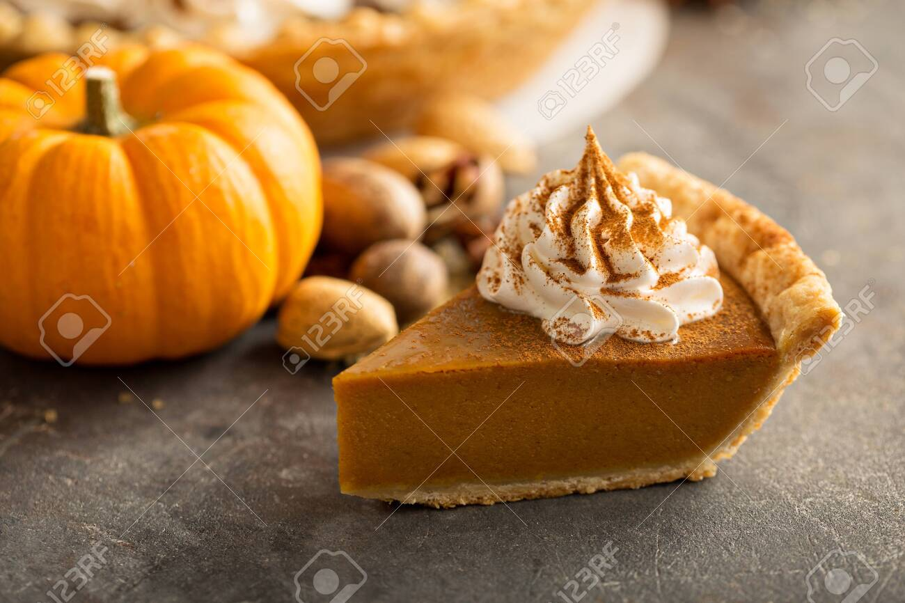 Traditional pumpkin pie with whipped cream - 130711416