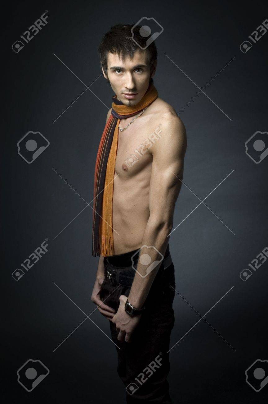 Young fashion male model with athletic body posing in colorful srarf Stock Photo - 4610622