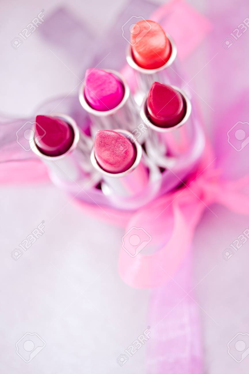 a set of lipsticks/lipglosses with decorative bows Stock Photo - 13230597