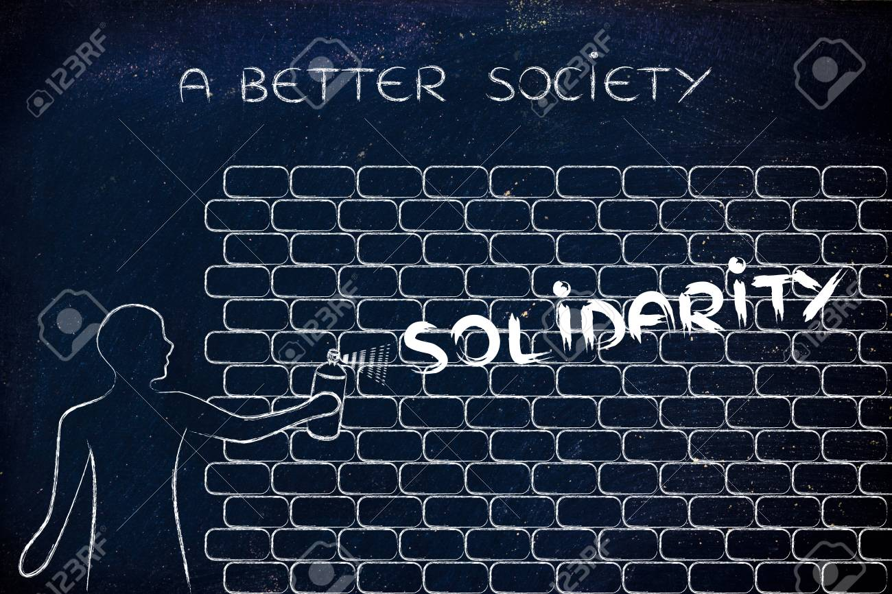 Person with spray paint writing the word solidarity as wall graffiti person with spray paint writing the word solidarity as wall graffiti a better society stock ccuart Image collections