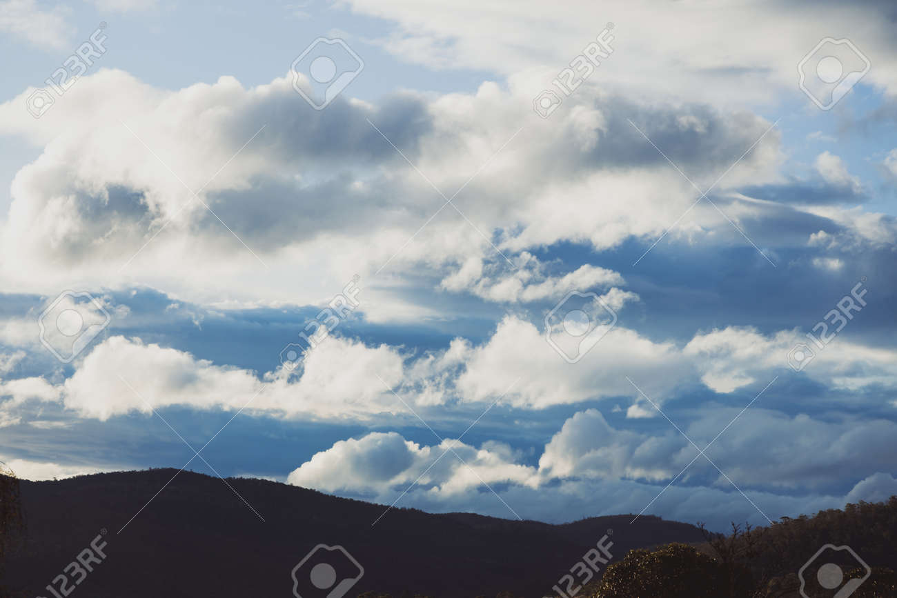 beautiful clouds over the mountains in Tasmania shot near Kunanyi also known as Mount Wellington - 147328848