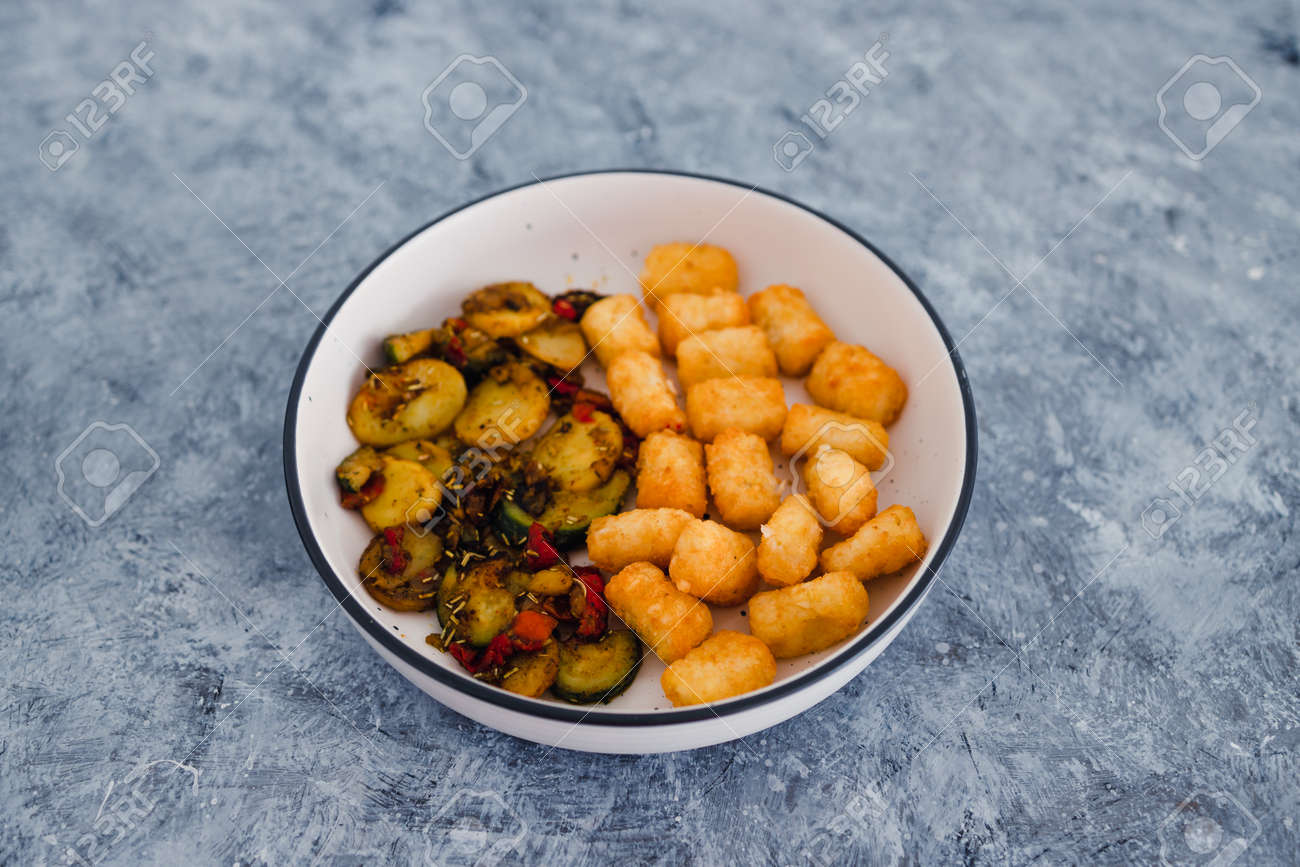 healthy plant-based food recipes concept, sauteed mediterranean vegetables with soy sauce and wir fried potato royals - 151988684
