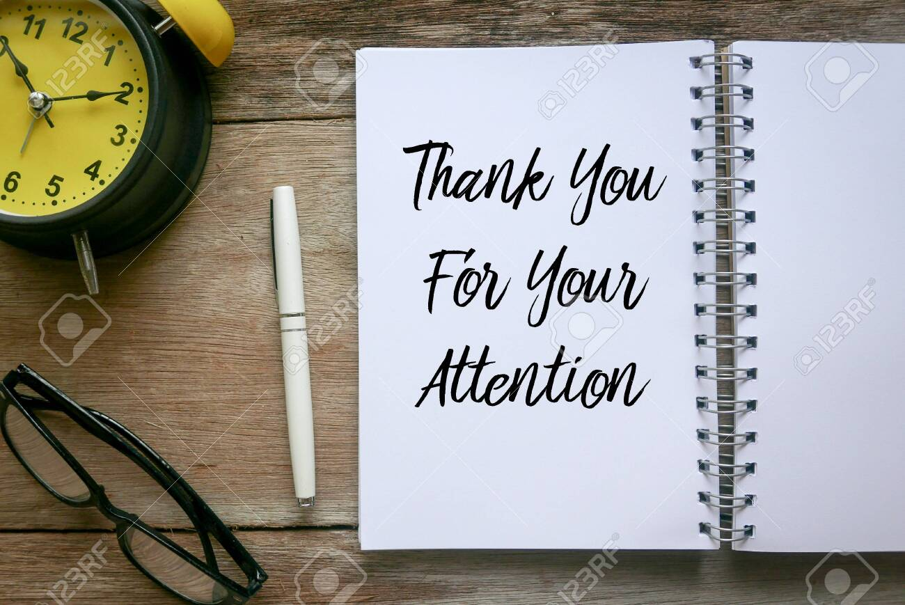 Top view of clock,glasses,pen and notebook written with Thank You For Your Attention on wooden background. - 135135991