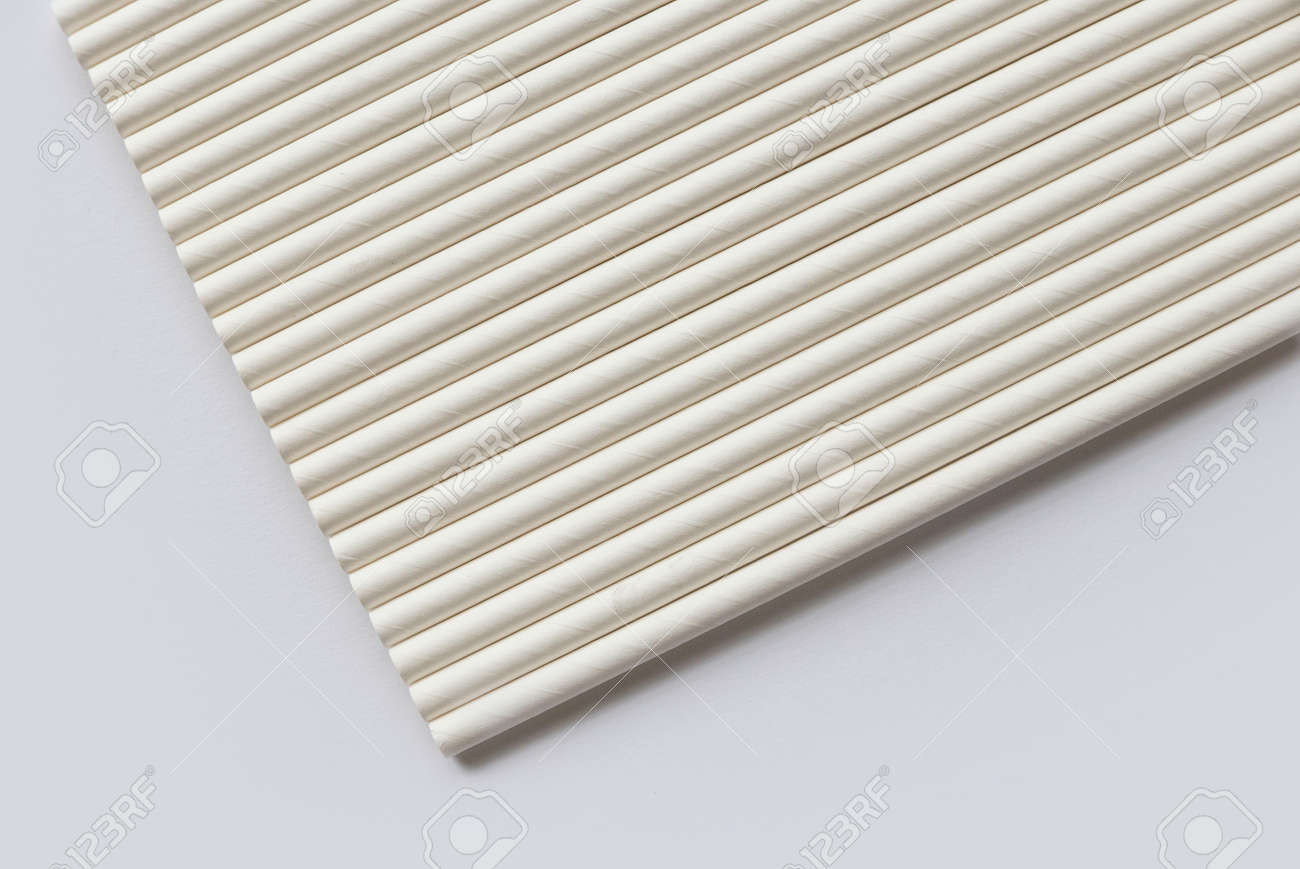 A row of biodegradable eco friendly white paper drinking straw isolated on white background - 169596856