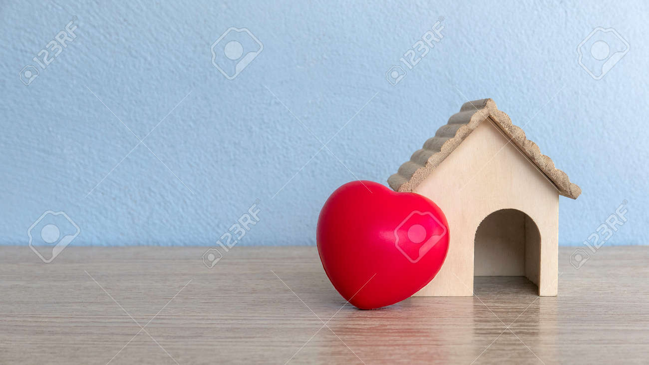 A house model and red heart love on table with copy space. - 169596860
