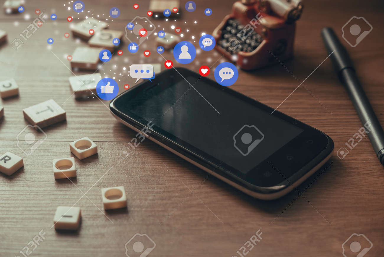 Smartphone or mobile phone with social media icon. Concept of social media and digital online. - 169596981